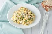 stock photo of scrambled eggs  - scrambled eggs with fresh herbs and red onion on white plate - JPG
