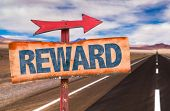 stock photo of paycheck  - Reward sign with road background - JPG