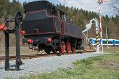 picture of train track  - The old steam locomotive is parked on track - JPG