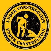 pic of shovel  - Round icon with the words Under Construction with a man shoveling in black and yellow - JPG