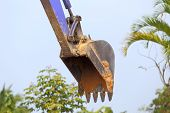 foto of backhoe  - backhoe tractor works on a construction site - JPG