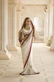 image of sari  - Beautiful young indian woman in traditional clothing with bridal makeup and oriental jewelry - JPG