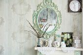 stock photo of vase flowers  - Vintage interior with mirror and a table with a vase and willows - JPG