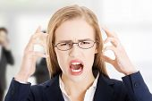 stock photo of yell  - Angry and frustrated business woman yelling - JPG
