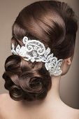 stock photo of lace  - Portrait of a beautiful woman in the image of the bride with lace in her hair - JPG