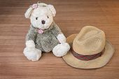 picture of baby cowboy  - Toy teddy bear and hat on wooden background - JPG