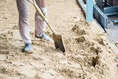 foto of spade  - man digging in the ground with shovel and spade - JPG