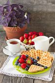 Постер, плакат: Morning Tea With Waffles Milk And Fresh Berries