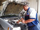 Mechanic Performing a Routine Service Inspection