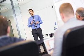 foto of employee  - Business man making a presentation at office - JPG