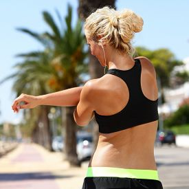 picture of cardio exercise  - Sport female runner stretching arms before running - JPG