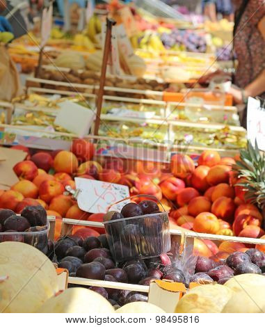 Stand With Basket Full Of Seasonal Fruits In The Local Market Of The City