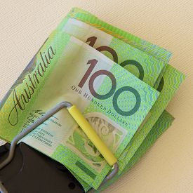 picture of mouse trap  - Australian one hundred dollar notes trapped in a mouse trap - JPG