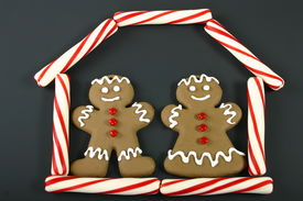 pic of gingerbread house  - gingerbread man and woman in a candy house on black background - JPG