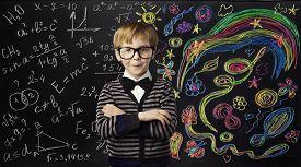 image of child development  - Kid Creativity Education Concept Child Learning Art Mathematics Formula School Boy Ideas on Black Chalk Board - JPG