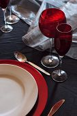 Modern table setting in red and black