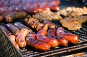 Sausages and other kinds of meat on a barbecue