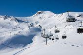 Ski lift in alps mountains, full ski season