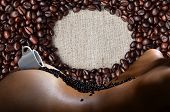 A Photograph Of A White Cup Of Hot Coffee With Lots Of Coffee Beans, Which Lies On A Beautiful And S poster