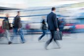 Blurred image of people rushing to office in the morning