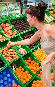 Healthy fruits food buying woman with apples in supermarket