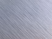 High resolution brushed metal. diagonal grain. Actual photo of brushed metal. Focus on entire surfac