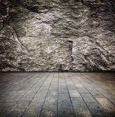 Under ground chamber with natural rock wall