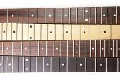 Guitar necks aligned, Rosewood, maple and ebony fingerboard necks