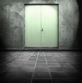 Grungy wall with green door