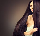 Beautiful long Hair. Beauty woman with luxurious straight black hair on dark background. Beautiful b poster