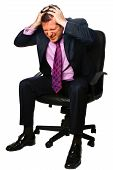 Stressed Businessman On Office Chair