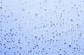 stock photo of rain-drop  - Blue rain drops background - JPG