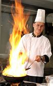 Professional cook preparing food on flame motion blurred - a series of RESTAURANT images.