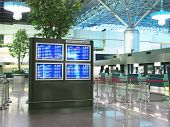 stock photo of over counter  - Flight schedule and check in counter in airport - JPG