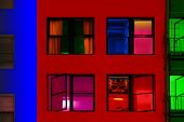 colorful buildings attached to each other in a row photographed at night
