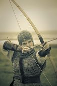 bows woman / medieval armor / historical story  / retro split toned