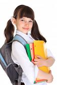 Half body portrait of young schoolgirl with books and bag, isolated on white background.