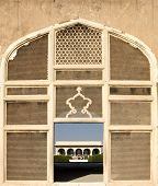 View at marble Bara Darri through handcrafted marble mesh window in Lahore Fort, Pakistan