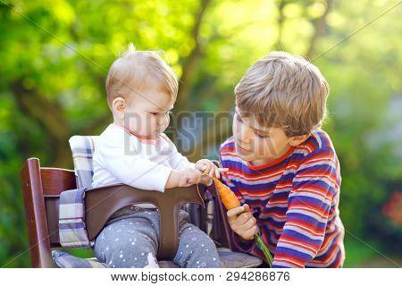 Little Blond Kid Boy Giving