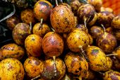 A Lot Of Passion Fruit On A Local Organic Food Market. Passion Fruit Background. poster