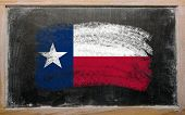 stock photo of texas state flag  - Chalky american state of texas flag painted with color chalk on old blackboard - JPG