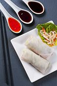image of lumpia  - Spring rolls with salad and sauces - JPG