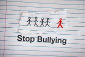 Stop Bullying. Phrase Stop Bullying On Notebook Sheet. Close Up. poster