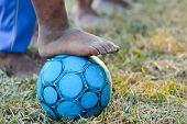 Dirty Feet Playing Football On The Field,barefoot Of Children Play Football Old,asian Boy Playing Ol poster