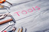 Set Of Work Tool On Rustic Wooden Background With Written tools In Space, Industry Engineer Tool C poster