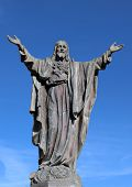 Concrete Statue Of Jesus With Thorn Encircled Heart Isolated On Blue Sky. Concept Jesus Heart Was Pi poster