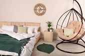 Modern Bedroom Interior With Comfortable Hanging Chair. Stylish Design poster