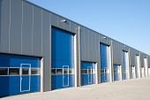 stock photo of loading dock  - Silver industrial unit with roller shutter doors - JPG