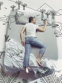 Back To The Dinosaur Era. Top View Photo Of Young Man Sleeping In A Big White Bed At Home. Dreams Co poster