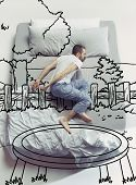 Trampoline Jumping. Top View Photo Of Young Man Sleeping In A Big White Bed At Home. Dreams Concept. poster